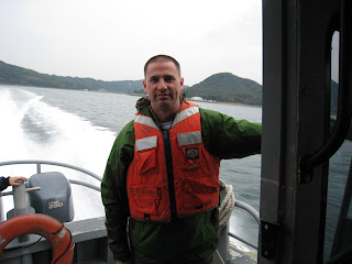 Agent Willie rides with Harbor Patrol in Omura Bay, Nagasaki Prefecture, Japan.