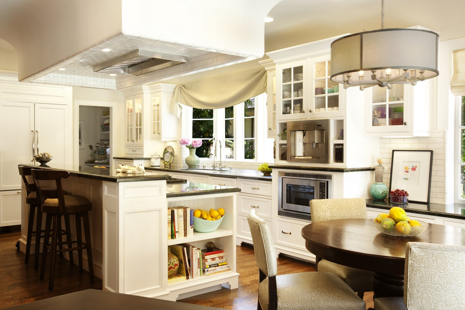 Locally made cabinetry and green soapstone countertops pair well with