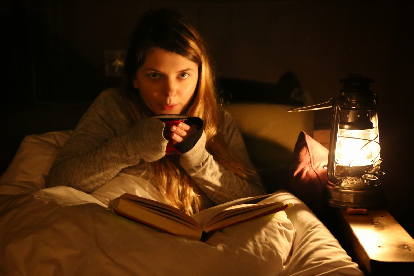 A night time cup of tea and reading, by paraffin lamp, Feather Down Farms,