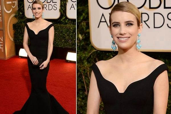Emma Roberts posing at 2014 Golden Globes Red Carpet