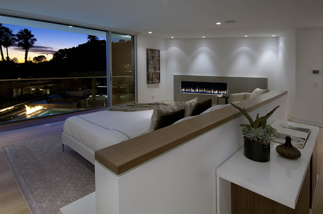 Picture of modern bedroom with fireplace and the view