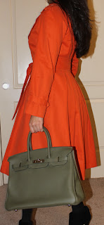 Bottega Veneta necklace, Calvin Klein opaque black stockings, Carolina Herrera dress and coat, Hermès Birkin, datejust Rolex