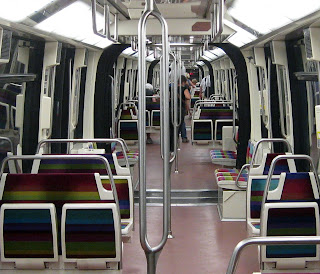 One of those long un-divided trains on Paris metro line 1