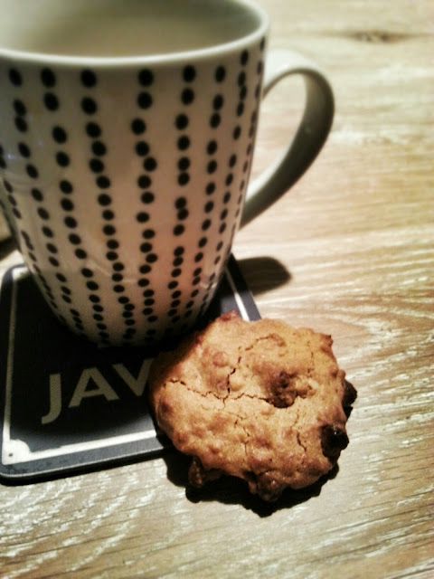 Peanut Butter Chocolate Chip Cookie and a cup of tea
