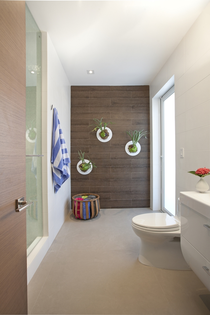 Toilette in Modern home by DKOR Interiors