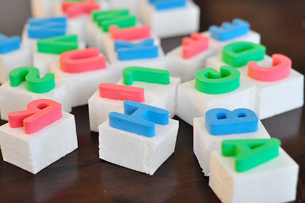 glue the letters wrong side up onto pieces of foam or wood and easy peasy large letter stamps for your kids