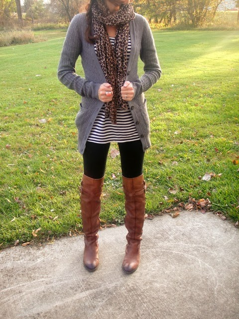 Cheetah mark scarf, cardigan, lined shirt and black leggings with long brown boots