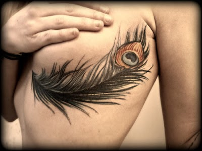 Peacock feather tattoo. The ultimate tattoo choice, for girls!