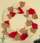 http://lasmanualidades.imujer.com/2009/12/23/como-hacer-una-corona-de-navidad