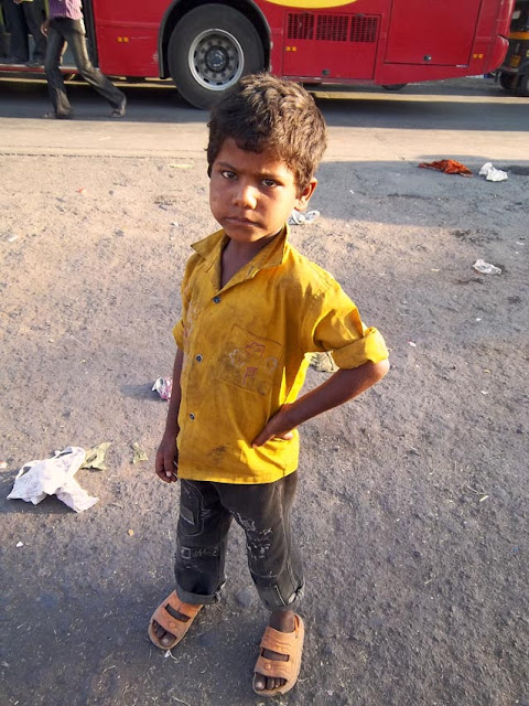 poor young boy on Indian street