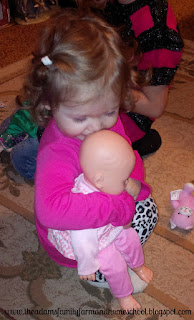 Kissing a baby doll