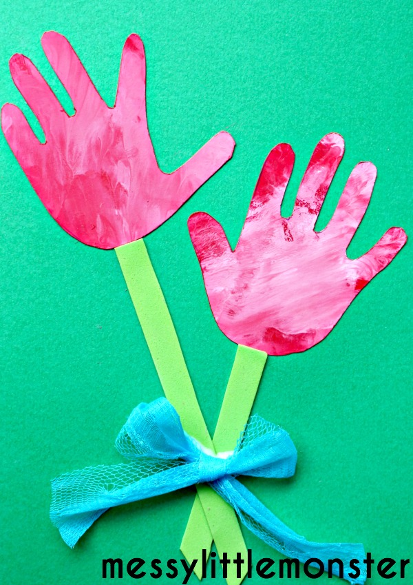 cut out the two hand shapes and stuck them onto green card. I then ...