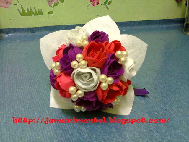 bunga tangan material felt dengan mutiara