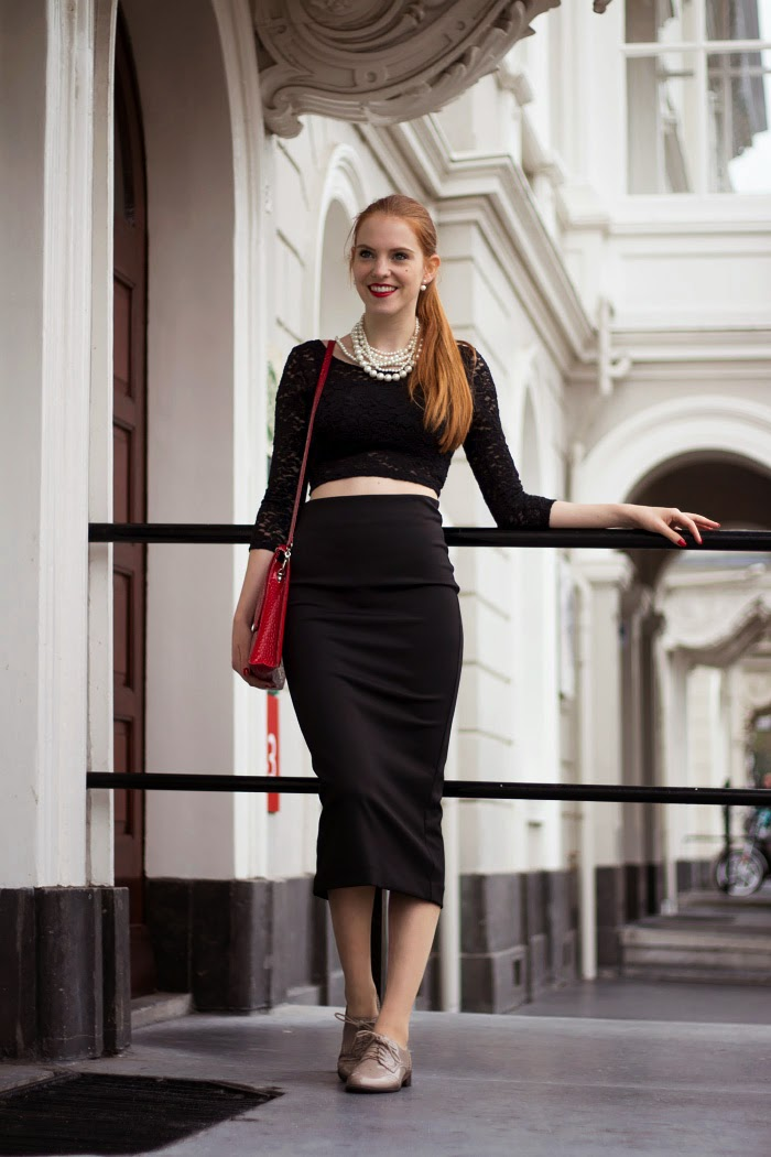 Black vintage fashion blogger outfit with a lace crop top and midi pencil skirt