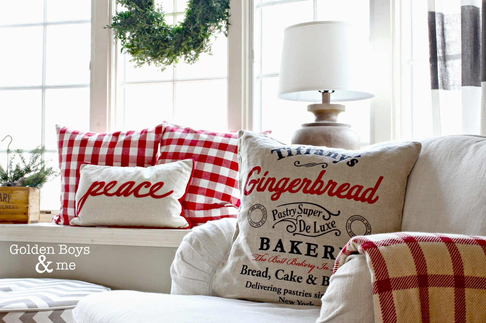 Red and white Christmas pillows in window seat and on Ikea Stocksund chair-www.goldenboysandme.com