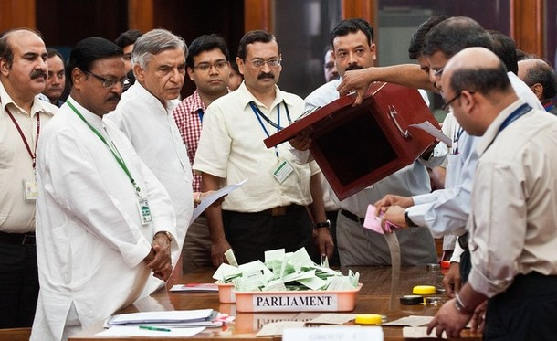 Sh. Satya Pal Jain, Counting Agent of Sh. P A Sangma, and Sh. Pawan Bansal, Counting Agent of Sh. Pranab Mukherjee, during the counting of votes for the Presidential Election at Parliament House, New Delhi. | AFP/GettyImages/Prakash Singh