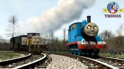 Little steam train Thomas the number one engine chuffed on with the Sodor diesels following behind