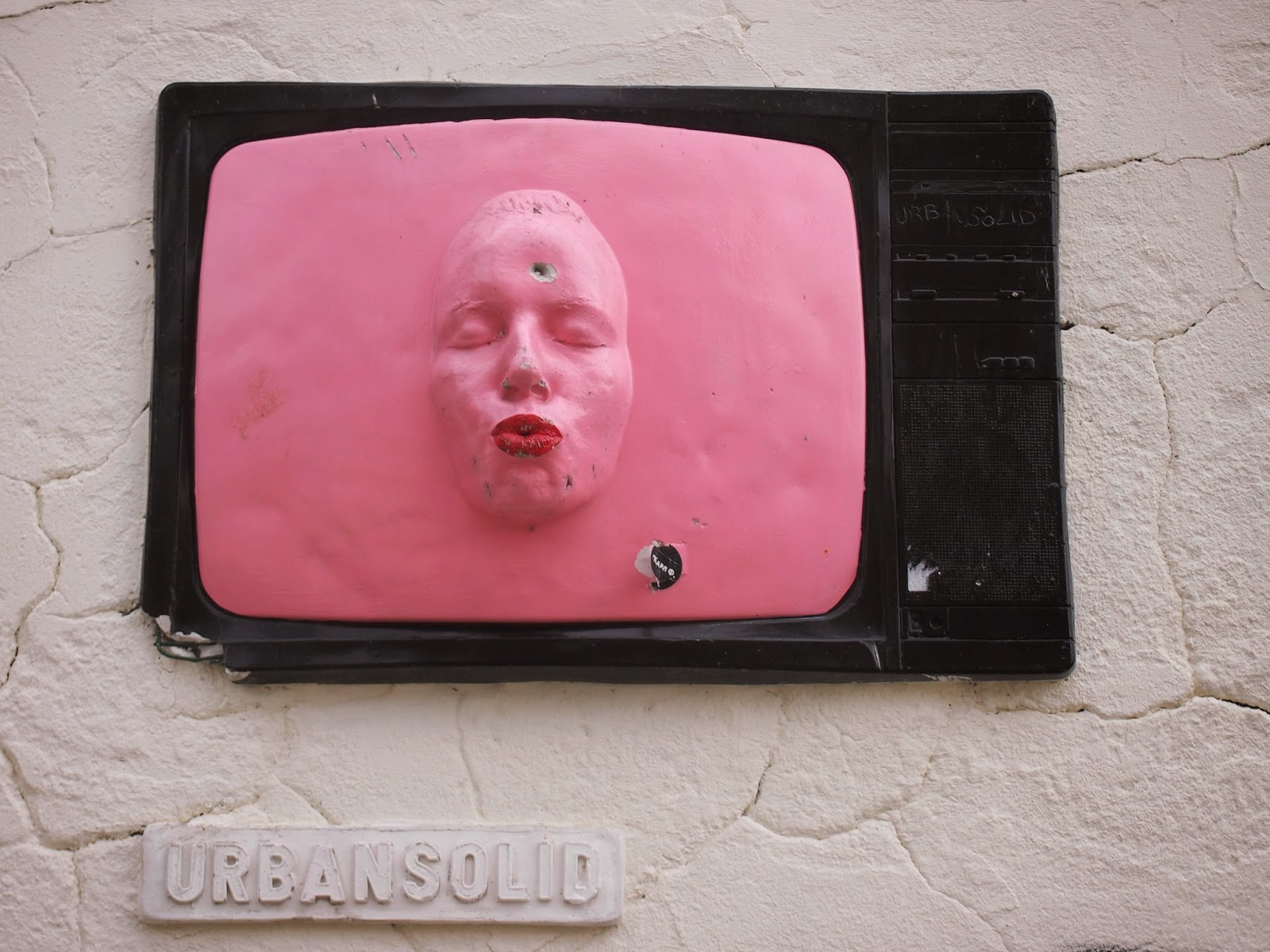A pink face in a tv at prague