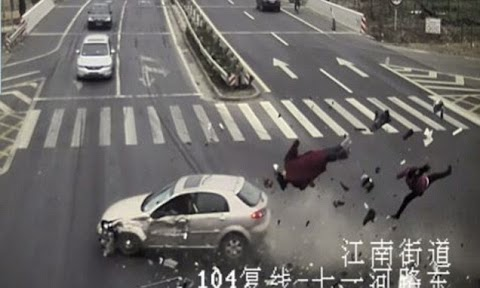 Shocking!The moment a couple who rode through a red light on their tricycle were sent flying and killed by a car