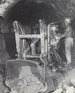 An underground loader in operation in the De Beers Mine at Kimberley.