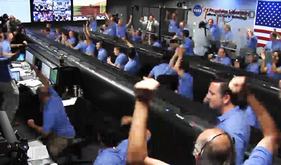 Curiosity MSL lands on Mars. Entry, Descent and Landing (EDL) team in blue shirts. Celebrate touchdown of Curiosity on Mars, fist in the air. 6 August 2012. NASA/JPL.