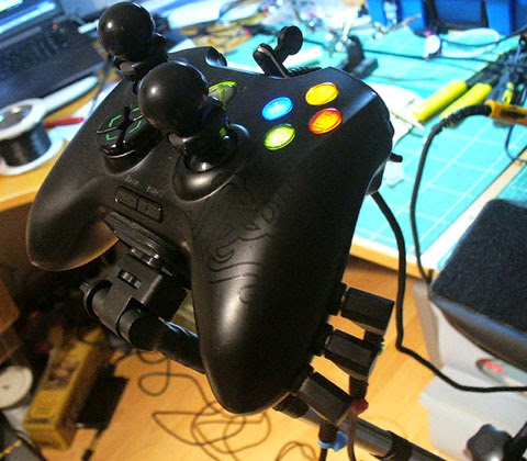 Accessible Game Controller. A switch adapted Onza Razer with RKade Freek joystick extensions.