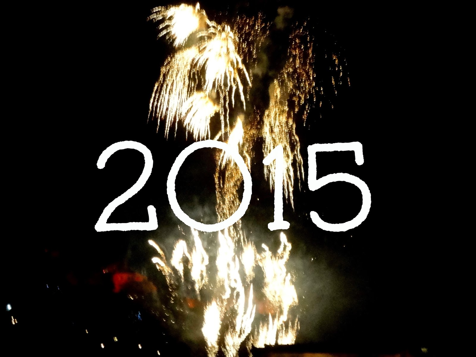 2015 text on New Year fireworks background from Edinburgh Hogmanay