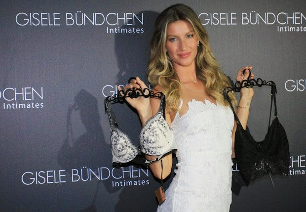 Short dress, Gisele Bundchen launches lingerie collection in Sao Paulo