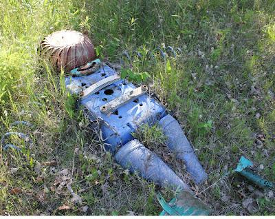 scrap metal figure sculpture in the woods