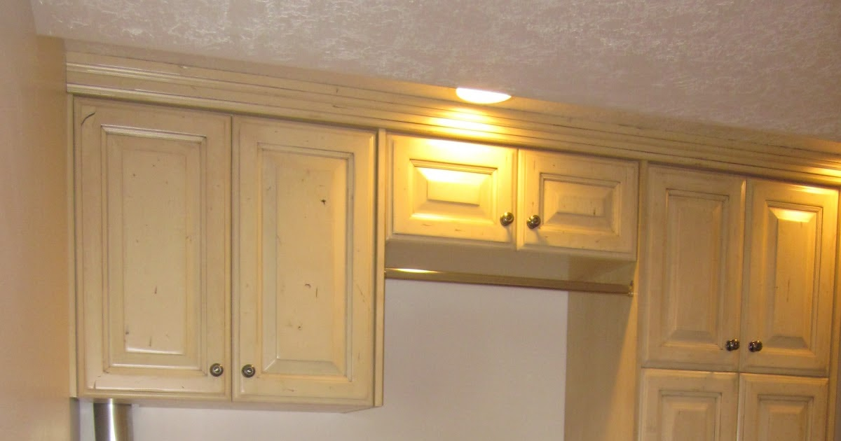 Stone ridge cabinets laundry with buttercream finish for Buttercream kitchen cabinets
