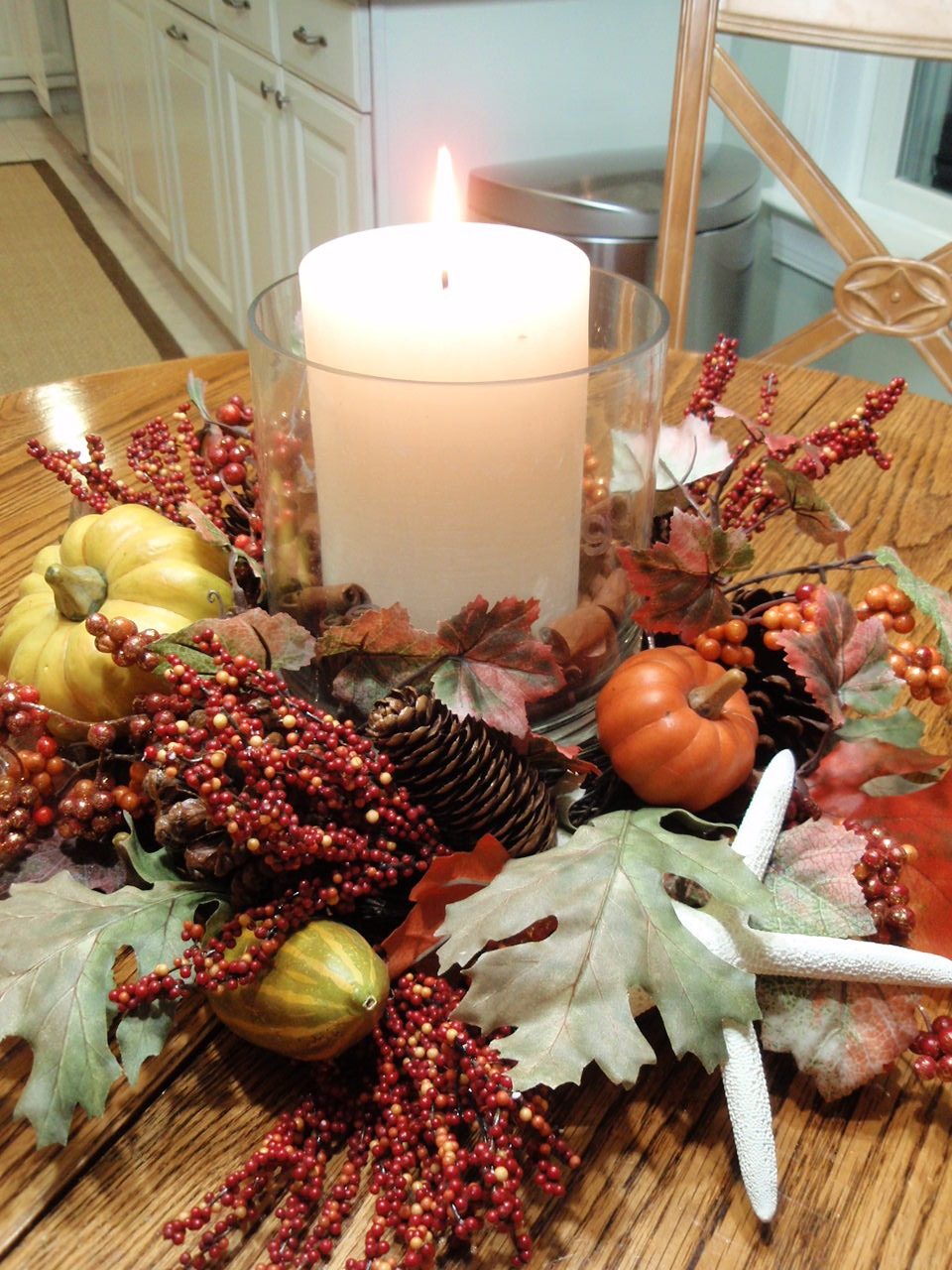 Modern vintage coastal happy thanksgiving welcome to my home i created the centerpiece with autumn garland pumpkins a candle and used chopped cinnamon sticks as a vase filler reviewsmspy