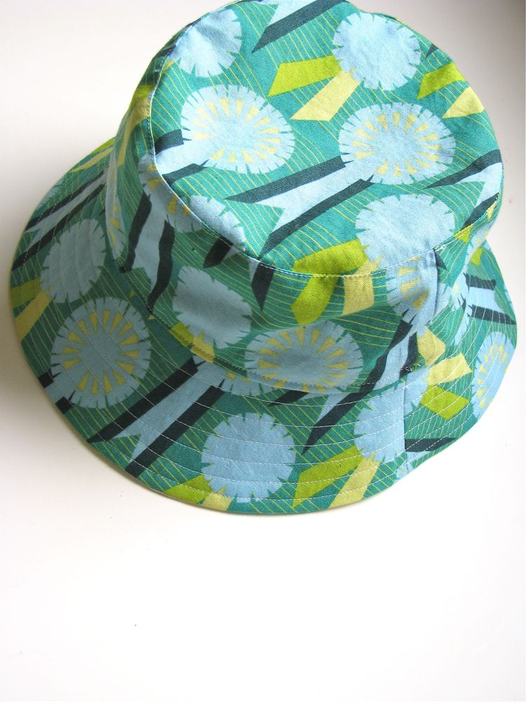 It is the one item of clothing that gets worn almost every day the entire  summer long. The Oliver+S Little Things to Sew Bucket Hat ... dfc5d1f270c