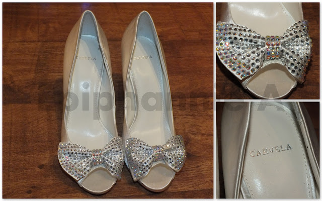 Epiphannie A These Kurt Geiger Carvela Ivory Peeptoe shoes with an