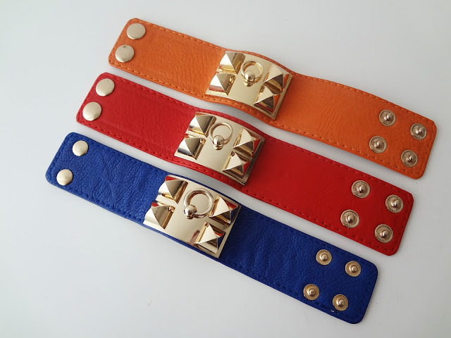 Gold Pyramid Stud Faux Leather Cuff Bracelets layed out flat.