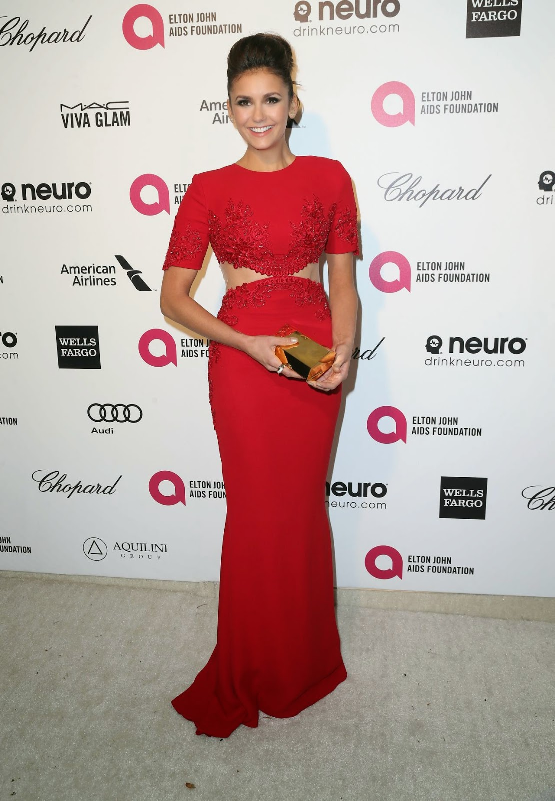 Nina Dobrev wears red Reem Acra to the 2015 Elton John Aids Foundation Oscars Party in LA