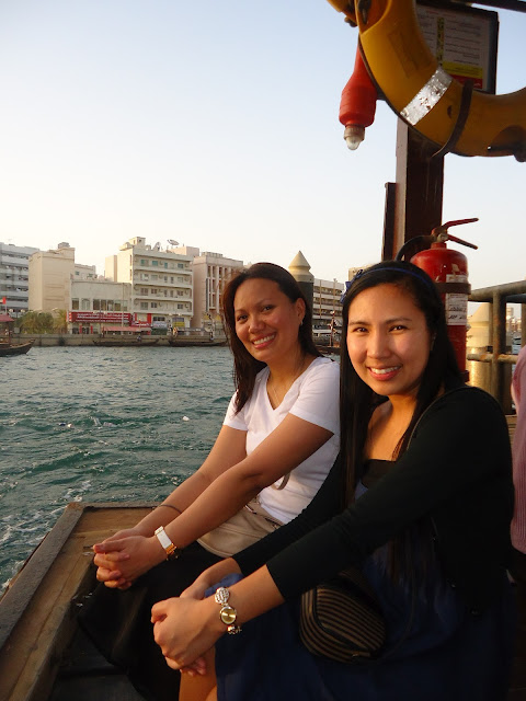 Lady and a friend riding an Abra in Dubai Creek