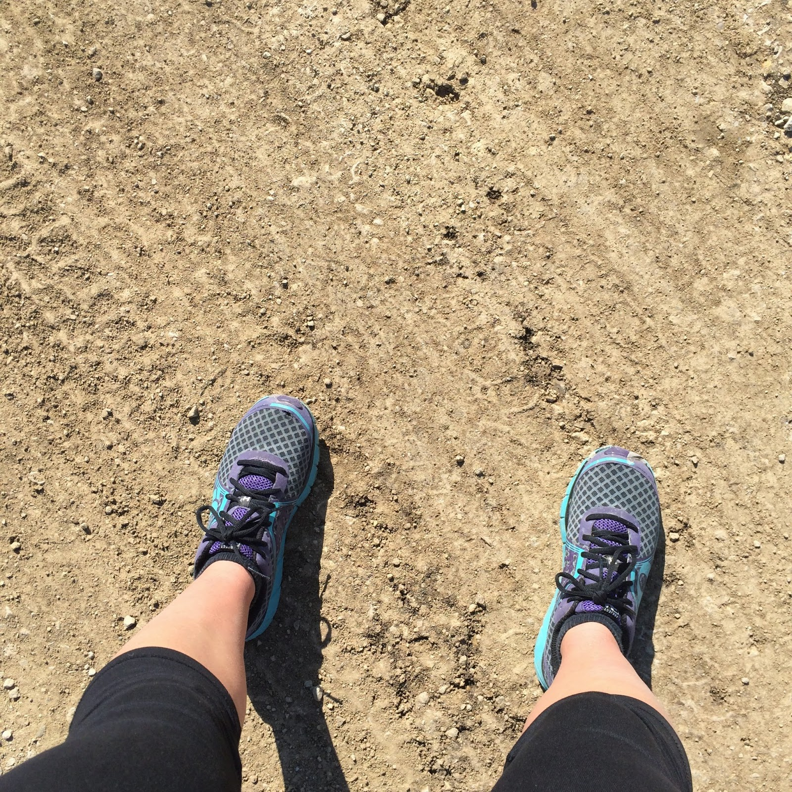 Running shoes on gravel road