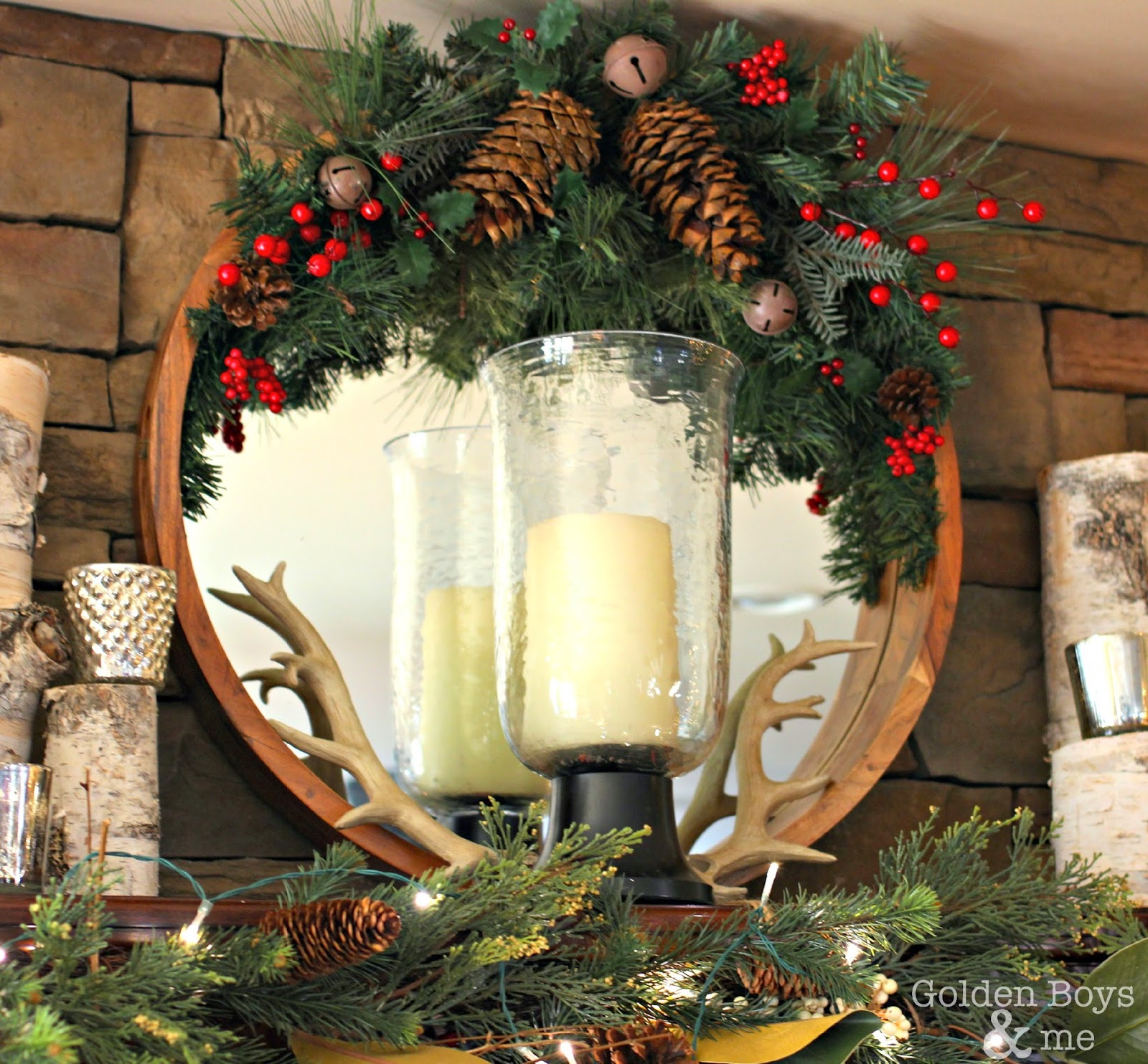 Round mirror with Christmas decor and antlers over stone fireplace in family room-www.goldenboysandme.com