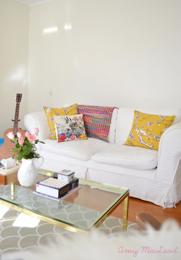 Colourful living room and rag rug on sofa // by Amy MacLeod - Five Kinds of Happy blog