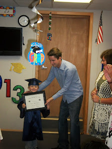 Logan gets his diploma from the principal