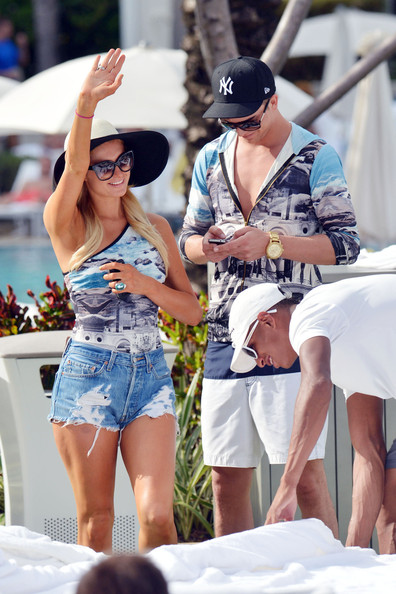Paris Hilton and Model Boyfriend Hit the Pool in Matching Outfits