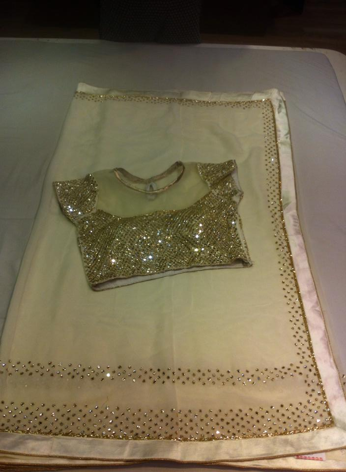 georgett fancy mirror work sari paired with designer