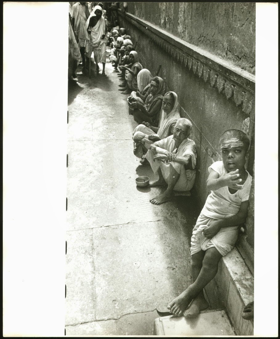 Hindu Widows are waiting in a Lane for Alms.  Probably in Varanasi - c1980's