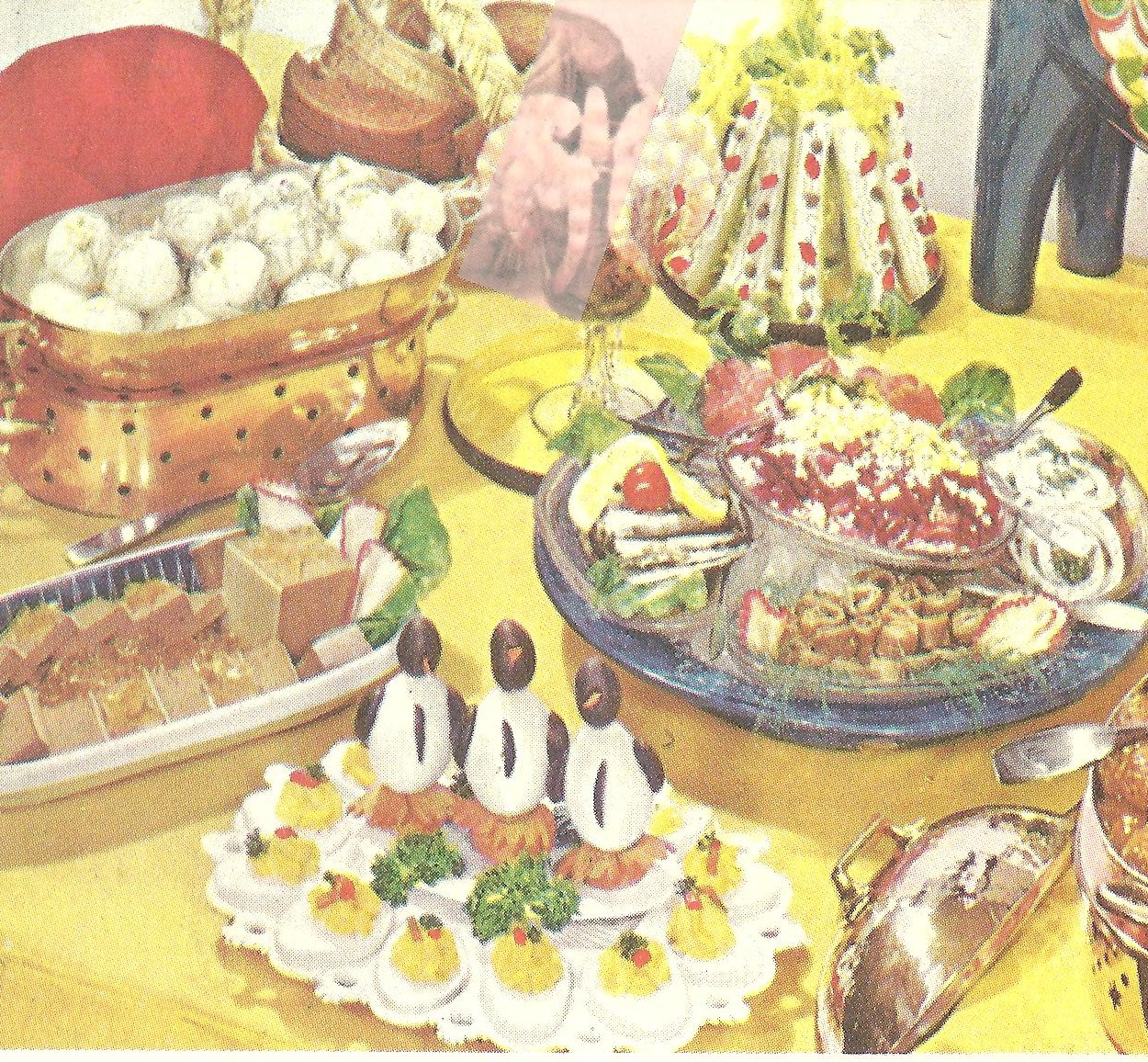 lots going on here celery sticks a spread of herring salad liver pate with chunks of aspic all of it is protected by a trio of egg penguins - Buffet Retro Cuisine