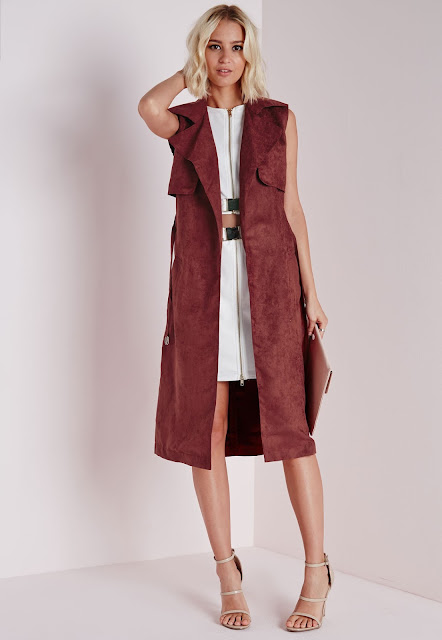 https://www.missguided.co.uk/clothing/category/coats-jackets/sleeveless-belted-trench-jacket-rust-rust