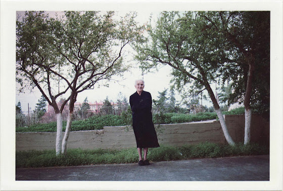 dirty photos - time - cretan landscape photo of old lady with black clothes