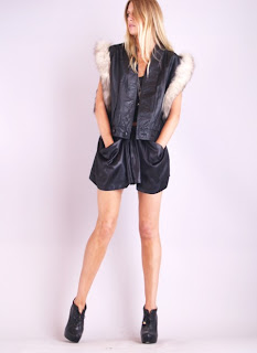 Vintage 1980's black leather moto biker vest with fox fur trim around the armholes.