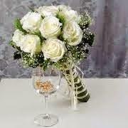 Handbouquet bunga mawar putih