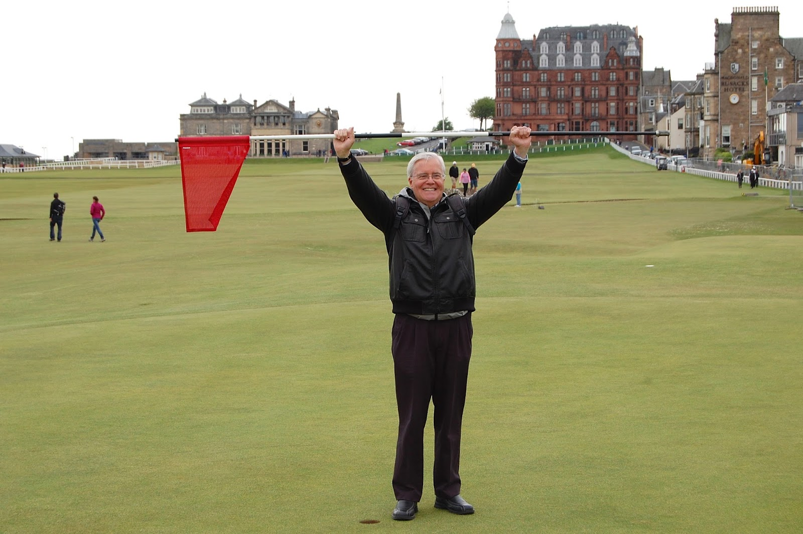 Holding a flag on the Old Course