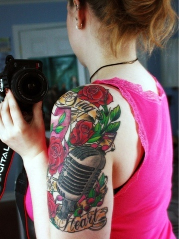 Colorful flower and mike tattoo